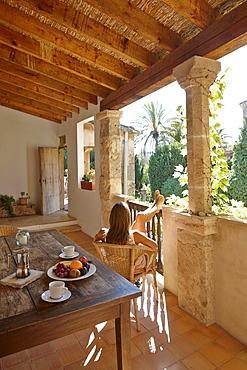 Woman relaxing on a loggia, Finca, Algaida, Mallorca, Balearic Islands, Spain