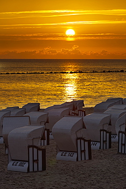Hooded beach chairs near Sellin pier in the morning light, Ruegen, Mecklenburg-Western Pomerania, Germany