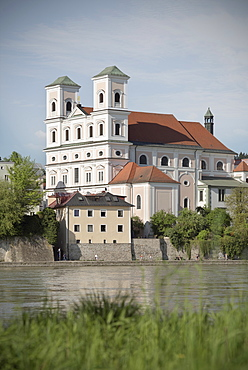 view of St. Michael's church with Inn river in the foreground, old town of Passau, Bavaria, Germany