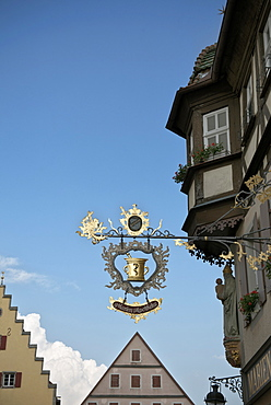 Pharmacy sign and houses in the old town of Rothenburg ob der Tauber, Romantic Road, Franconia, Bavaria, Germany
