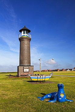 Lighthouse with seal sculpture, Juist Island, Nationalpark, North Sea, East Frisian Islands, East Frisia, Lower Saxony, Germany, Europe