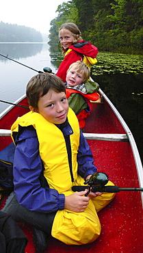 Kids in Canoe Fishing, Bear Paw Lake, Muskoka, Ontario