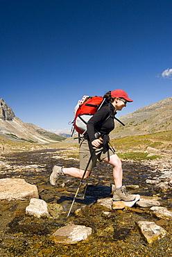 Woman Hiking through Skyline Trail, Jasper National Park, Alberta