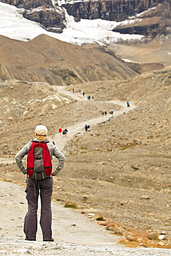 Woman hiker on trail to Athabasca Glacier, Columbia Icefields, Jasper National Park, Alberta