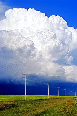 Power lines with a cumulonimbus supercell cloud mass, near Bromhead, Saskatchewan