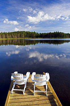 Adirondack chairs on dock, Two Mile Lake, Duck Mountain Provincial Park, Manitoba