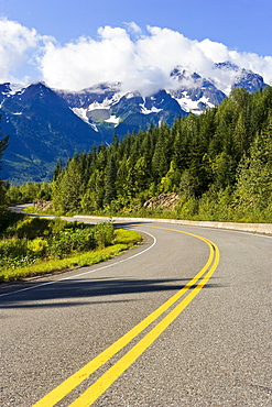 Road curving through mountain landscape, Highway 37A, Northern British Columbia