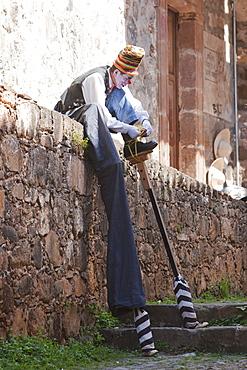 Clown putting on stilts, Putzcuaro, Michoacun, Mexico