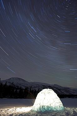 Igloo and star trails, Kusawa Lake, Yukon
