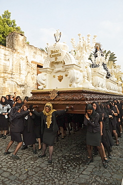 Women dressed in mourning carry the anda (float) of the sorrowful Virgin Mary during the Holy Burial Procession on Good Friday in Antigua Guatemala, Sacatepuquez, Guatemala