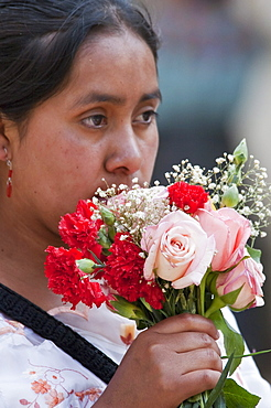 Maya woman with a bouquet of roses & carnations, Antigua, Sacatepuquez, Guatemala