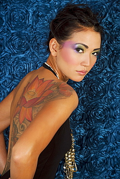 Hawaii, Portrait of stylish Asian woman with large tattoo on back.