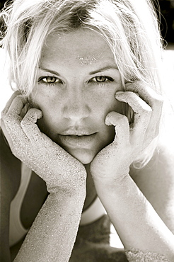 Hawaii, Big Island, Beautiful blond woman covered in sand, Black and white.