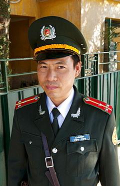 South East Asia, Vietnam, Hanoi, A policeman poses for his portrait.