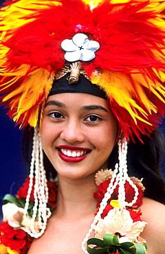 French Polynesia, Tahiti, Bora Bora, Headshot of a beautiful Tahitian dancer in headdress.