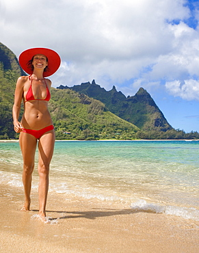 Hawaii, Kauai, Bali Hai, Woman walking on Tunnels Beach.