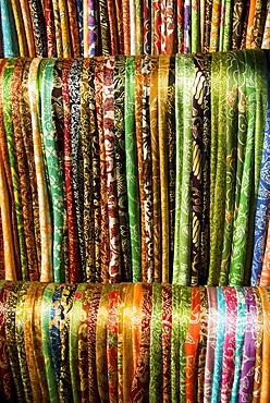 Indonesia, Bali, Ubud, Silk scarves for sale at market.