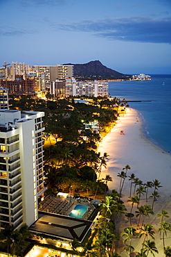 Hawaii, Oahu, Waikiki Beach and Diamond Head in the evening.