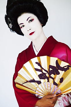 Traditional portrait of a Geisha with Japenese fan.