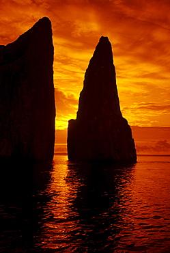 Galapagos, Orange sunrise over Kicker Rock.