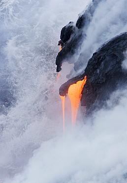 Hawaii, Big Island, near Kalapana, Pahoehoe lava flowing from Kilauea into Pacific Ocean.