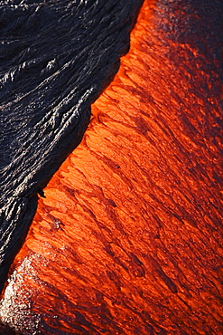 Hawaii, Big Island, Hawaii Volcanoes National Park, Kilauea Volcano, Detail of molten pahoehoe lava flowing downward.