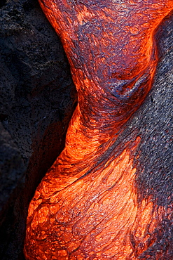 Hawaii, Big Island, Hawaii Volcanoes National Park, Kilauea Volcano, Detail of flowing molten pahoehoe lava.