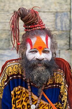 Nepal, Kathmandu, painted religious man at Pashupatinath holy Hindu place on Bagmati River.