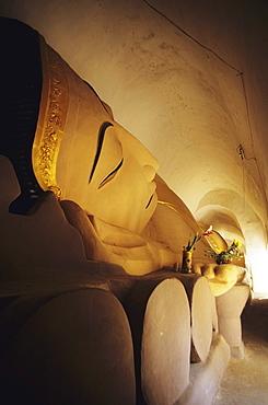 Burma (Myanmar), Bagan, Manuha Paya, angled close-up view of reclining Buddha.