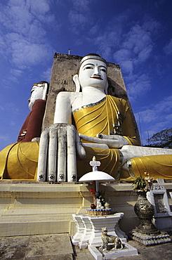 Burma (Myanmar), Bago, Kyaik Pun Paya, large Budhha statues, altar in foreground.
