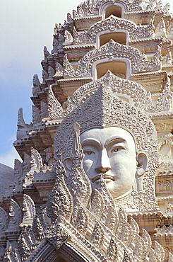 Thailand, Bangkok, Wat Ratchapradt, Buddha Image on ornate stone temple.