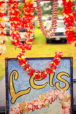 Hawaii, Big Island, Hilo, Lei and flower stand sign