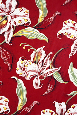 Closeup of red Aloha shirt with orchid flowers