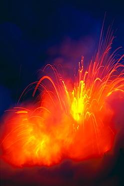 Hawaii, Big Island, Hawaii Volcanoes National Park, lava exploding as flow hits ocean, nighttime A28G