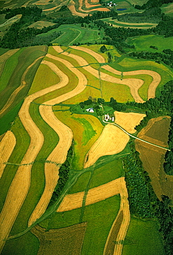 Agriculture - Aerial view of a farmstead and contour strip agricultural fields / Carol County, Maryland, USA.