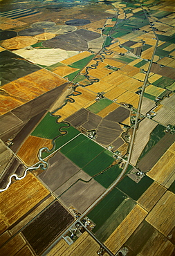 Agriculture - Aerial view of cultivated and fallow agricultural fields with a highway and river passing through / near Idaho Falls, Idaho, USA.