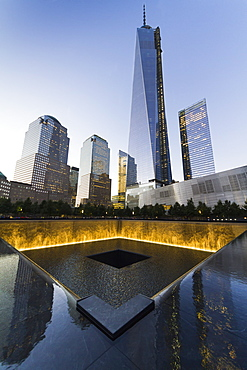 The National September 11 Memorial and One World Trade Center at night, New York City, New York, United States