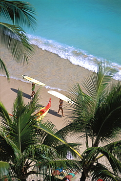 Hawaii, Oahu, Shoreline At Waikiki Beach, Surfers Carry Surfboards Atop Head D1511