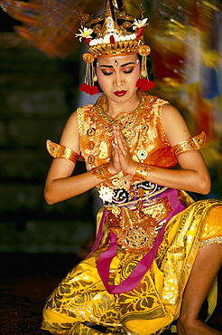 Indonesia, Bali, Ramayana Dancer Posing, Eyes Closed And Hands Together B1761