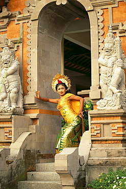 Indonesia, Bali, Legong Dancer Poses In Entranceway B1760