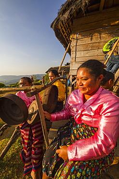 Manggarai women playing percussion instruments, Melo village, Flores, East Nusa Tenggara, Indonesia