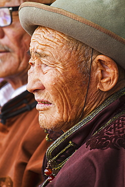 Elderly man wearing a deel, the Mongolian traditional costume, at the Naadam Festival in Mandal Ovoo, Ömnögovi Province, Mongolia