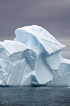 Gigantic Icebergs Adrift In Waddington Bay Against A Cloudy Sky, Antarctica