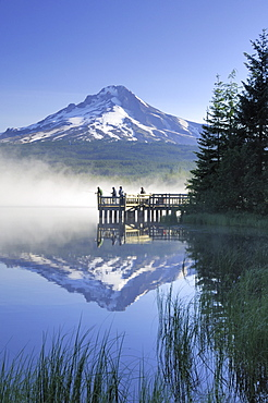 Fishermen Casting From A Dock On A Foggy Morning, Trillium Lake, Oregon