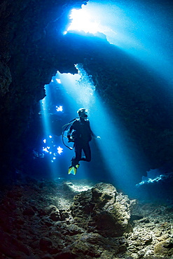 Diver inside a cavern known as First Cathedral off the island of Lanai, Hawaii, United States of America