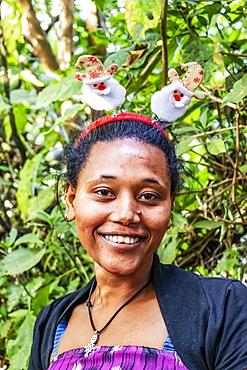 Ethiopian woman wearing a Christmas headband, Lake Tana, Amhara Region, Ethiopia