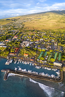 An aerial view of Lahaina harbor and town including the Pioneer Inn and West Maui Mountains, Maui, Hawaii, USA. Three images were combined for this panorama, Lahaina, Maui, Hawaii, United States of America