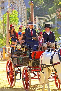 People on horse-drawn carriage, Annual Horse Fair, Jerez de la Frontera, Cadiz Province, Andalusia, Spain, Europe