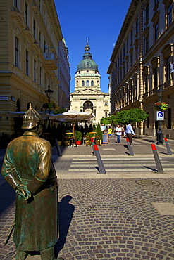 Statue of Policeman with St. Stephen's Basilica, Budapest, Hungary, Europe