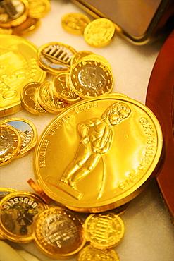 Manneken Pis coin in a sweet shop, Brussels, Belgium, Europe